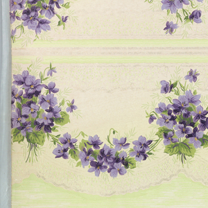 """Borders printed two across the width (mirrored). Floral swag with purple flowers, underneath which are a scalloped treillage pattern and green panel with moiret, divided by waving lines. Ground is white. Printed in purples, greens, white mica.  Printed in selvedge: """"Standard Papers"""""""