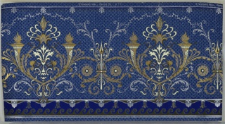 Alternating large and small foliate medallions with torches and spear, connected by waving foliate scrolls and foliate vining. Bottom has scrolls, waves, and floral motifs. Top has key pattern and floral motif. Background is a white and blue grid. Ground is a dark blue. Printed in blues, cream, gold micas, silver mica, and dark brown green.