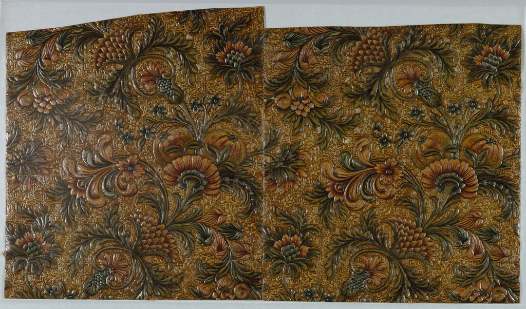 Imitation leather, highly embossed and lacquered stylized fruit, flowers, leaves, on all-over background pattern of small lineal squares and meandering, flowering tendrils. Green, apricot, and ochre. Two joined pieces.