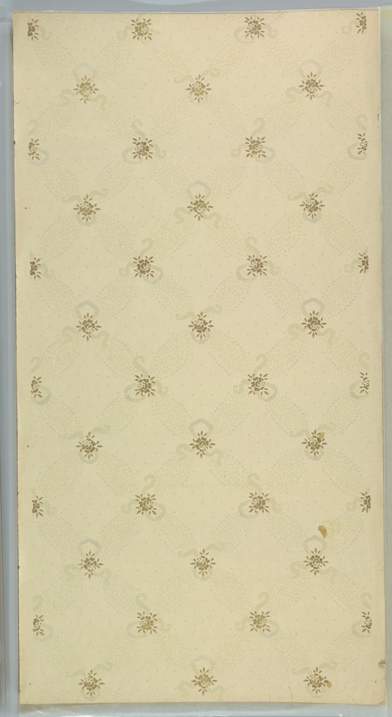 """Mosaic and beading lattice pattern with metallic rose and stylized ribbon centers over a bacground of a large dot grid. Printed on pink-beige ground in tan-beige, white liquid mica and gold liquid mica. Printed in selvedge: """"York Card & Paper Co."""""""