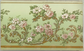 Flitter frieze. Waving foliate scrolls with vining pink flowers. Ground shades from green to light green. Printed in greens, pinks, white, gold mica flakes (outlining design), liquid gold mica, and brown. Water damage along the bottom. 