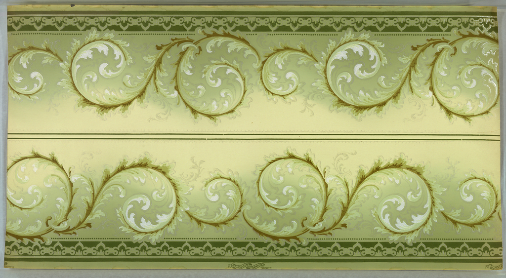 "Borders printed two across. Undulated bands of foliate wave scrolls. Bottom band of brattishing with beading, top band of beading. Ground fades light green to light yellow. Printed in greens, brown, white and white liquid mica. Printed in selvedge ""Standard Papers"""