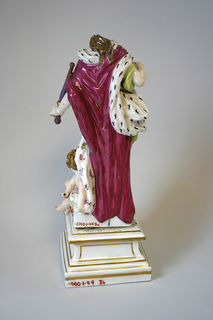 """""""Europe"""" standing female figure, wearing erine and crown, holding goose pen and sceptre; attended by putto, leaning on globe; attributes: book and sword; square pedestal."""