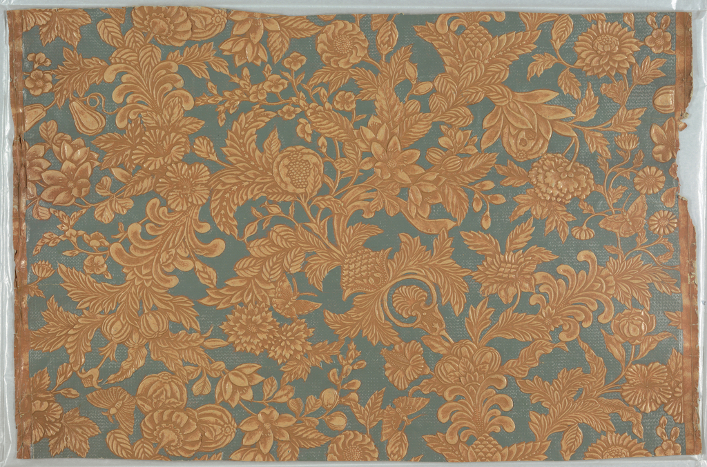 Imitation leather. Stylized floral and foliate design with scattered butterflies. Heavily embossed to imitate tooled leather. Printed in turquoise, light and dark tan.