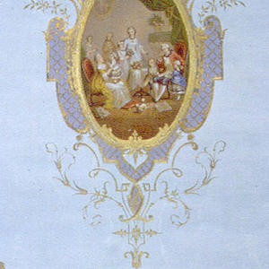 Vertical rectangle. In center, neo-baroque frame printed in green and violet, over-stamped in gold; repeating on field, scattered floral ornaments in green and gold, suggestive of Persian vase with flowers. Frame enclosed applied oval medallion with lithographed representation, in colors, of an interior with family gathering of men, women and children, in the costume of about 1770. Printed on blue moire ground.