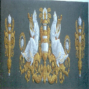 Horizontal rectangle in symmetrical design. In center, yellow and white urn, flanked by two Grecian figures playing the lyre, seated on yellow acanthus scrolls. At either side, a torch encased in yellow acanthus and palm leaves, on warm gray ground.