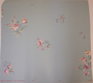 Floral motifs, such as roses and carnations, widely spaced. A few butterflies. A very large repeat but figures comparatively small, printed in multi-color on pale blue ground.