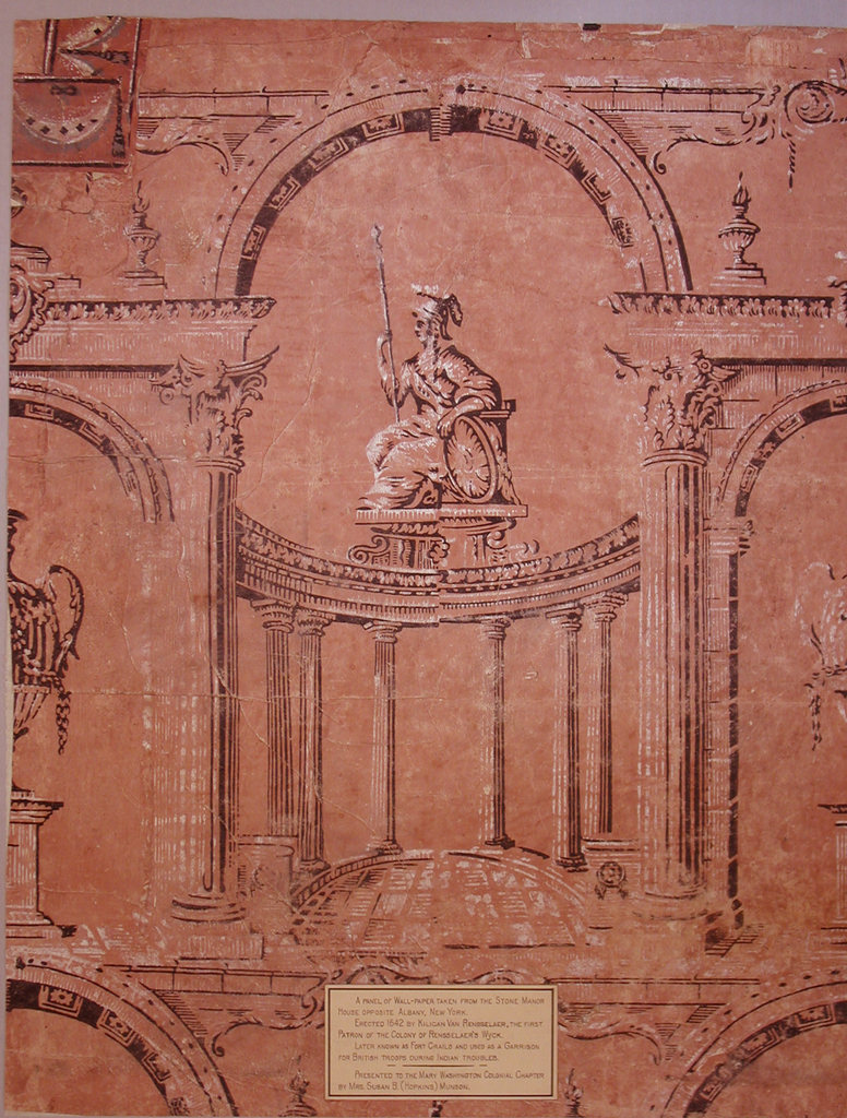 "Pillar and arch design. The framework is composed of a major arch resting upon Corinthian columns.  Looking through the major arch, ""Britannia"" is seen enthroned atop a curved colonnade of Doric columns.  Britannia is shown facing left, holding a spear, resting on her shield.  The minor arches contain a large-scale urn sitting on a pedestal.   Printed in black and white on a terra cotta ground.  A label giving provenance is pasted near the center bottom edge."