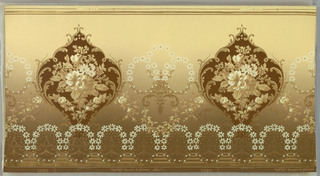 Large foliate medallions containing floral bouquet, alternate with group of three floral wreaths. A band of floral wreaths runs along the bottom edge. Background shades from light tan at top to dark tan at bottom.