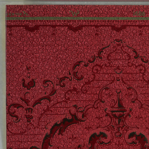 Printed on mottled red ground, large and small medallions alternating. Printed in dark red and black. The background on the lower half of the paper is printed green.