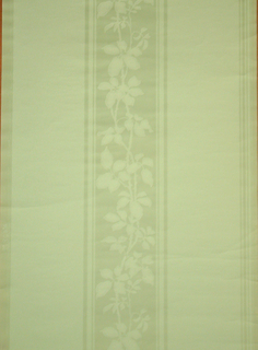 Central band containing floral stripe, with wide bands running along either edge of solid green. Printed in light mint green.
