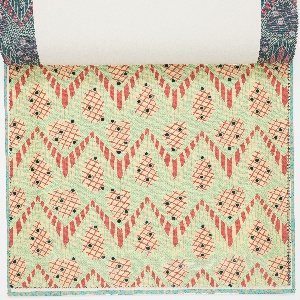 Sample book of printed textiles and wallpaper.