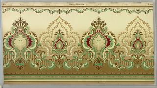 """Moresque"" frieze with horizontally repeating pattern of alternating spade-like medallions formed by c and s scrolls and stylized foliate motifs. Top edge is bordered by vertical, comb-like striations and scalloped c and s scrolls. Bottom edge is bordered by green lines and patterns of dots and trefoils. Pattern is machine-printed in browns, greens, tans and dark red on a tan background."