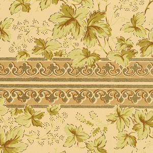 Wide top band of foliate sprigs. Narrow band of gothic architectural molding at lower edge. Two borders printed across the width. Printed in shades of green and tan on taupe ground.