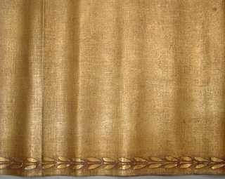 Stencilled canvas wallcovering from the Andrew Carnegie Mansion, 2 East 91st Street, New York City. Horizontal band of laurel leaves in gold on tan ground, stencilled at top of orange-brown plain canvas wallcovering.