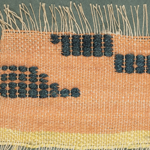 A woven sample included in a notebook covered in handwoven fabric and put together by Edith Huntington Snow of 37 woven samples.