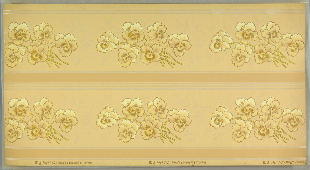 Repeating motif of pansy-like flowers, in clusters of six flowers. Flowing around these clusters are foliate sprigs, printed in mica. Borders printed two across. Printed on beige ground.