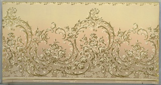 Horizontally repeating rococo-inspired pattern. Spindly scrollwork of stylized acanthus leaves and rosebuds rests on a meshwork of flowers and lines. A thin, foliate border runs across the top of the page. Design is machine-printed in olive green and khaki atop an ombre background that, from top to bottom, fades from light brown to pink to tan.