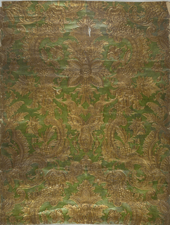 Imitation leather. Embossed symmetrical rococo foliate and floral pattern of realistic and symbolic motifs on background of stippled texture; printed in metallic lime-green and metallic gold.