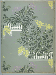 One full repeat of a drop repeat of two large leafy green bushes, one with violet flowers, one with yellow edged in white, each springing from a white balustrade.