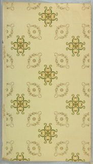 A stylized floral motif forming a quatrefoil-like design. This is centered between four ovoid foliate wreaths. Printed in brown and green on light yellow-green ground.