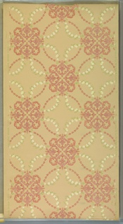 """Pink stylized foliate medallions connected by stylized pink floral wreaths and white flower swags. Beige ground. Printed in pinks, greem, white, yellow and pink mica. Printed in right selvedge: """"S.A. Maxwell & Co. New York & Chicago 18"""". Printed in left selvedge: """"Exclusive Design 2489""""."""