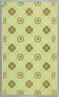 Grid pattern formed by foliate links, alternating circle and square motifs at intersections, with the squares composed of four flowers. Printed in light green ground.