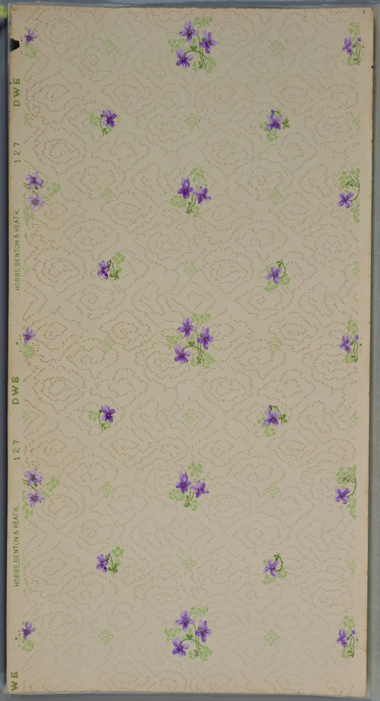 On lavender ground with lightly printed white treillage and staggered clusters of purple flowers.
