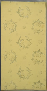 Medallions of scrolling foliage with stylized flowers. Individual large and small flowers are interspersed between medallions. Light yellow ground. Printed in greens and white liquid mica. Slight water damage.