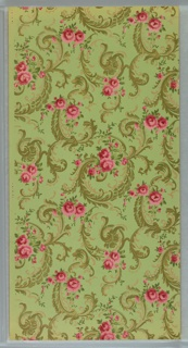 On green-tan ground, scrolls in green and gold with clusters of pink roses throughout.