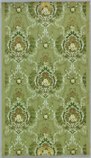 On green ground, white scroll treillage with anthemion motifs composed of green rinceaux, scrolled white frames green and gold, and bouquet of cream flowers at center.
