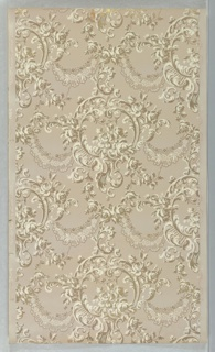 On gray ground, central scroll motif containing cluster of roses; some garlands, scrolls, c-curves, and vines. Printed in white and metallic gold.