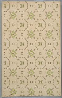 Rows of circular shapes each containing a four-pointed star in center, alternates with rows of similar four-pointed star with a projection on each side, forming a grid or trellis pattern. Printed in green and metallic gold on tan ground.