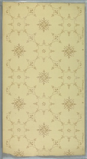 Large floral diaper pattern with fleuron interiors and flower motifs. Light beige ground. Printed in beige, tan and white.