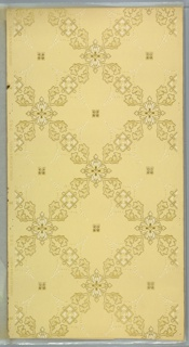 "Large lattice design of geometric and foliate medallions. Center of each square space has fleuron and beading that forms petal-like design. Background of light dots and vermiculation. Beige ground. Printed in tans, white and metallic gold. Printed in selvedge: ""Hobbs. Benton & Heath."" Pattern number ""385"" ""E"""