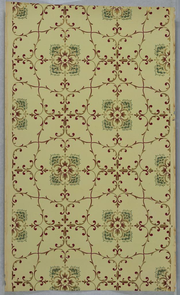 Foliate scroll trellis framework, floral quatrefoil motif fills adjacent voids, alternating with a fill of four foliate motifs. Printed on light yellow ground.