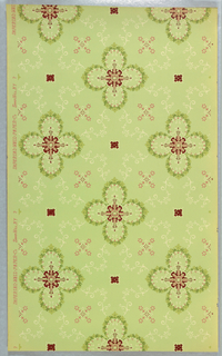 Quatrefoil motifs composed of floral swags linked together by foliate scroll work, floral cross-shapes in line with quatrefoils. Printed on light green ground.