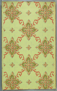 Large quatrefoils linked together by scrolling acanthus foliage, smaller quatrefoil centered in voids. Printed in red, green, yellow, and gray mica on light green ground.
