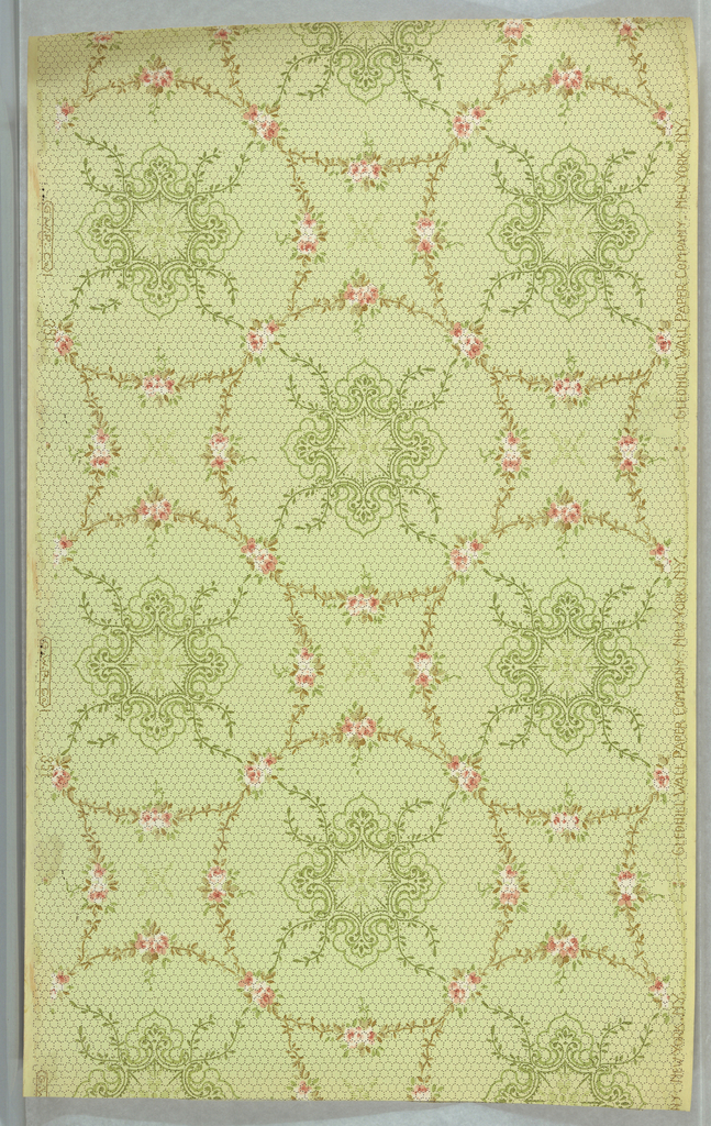 Enjoined circles composed of floral swags, quatrefoil medllion in center of each. Printed on honeycomb-patterned light green background.