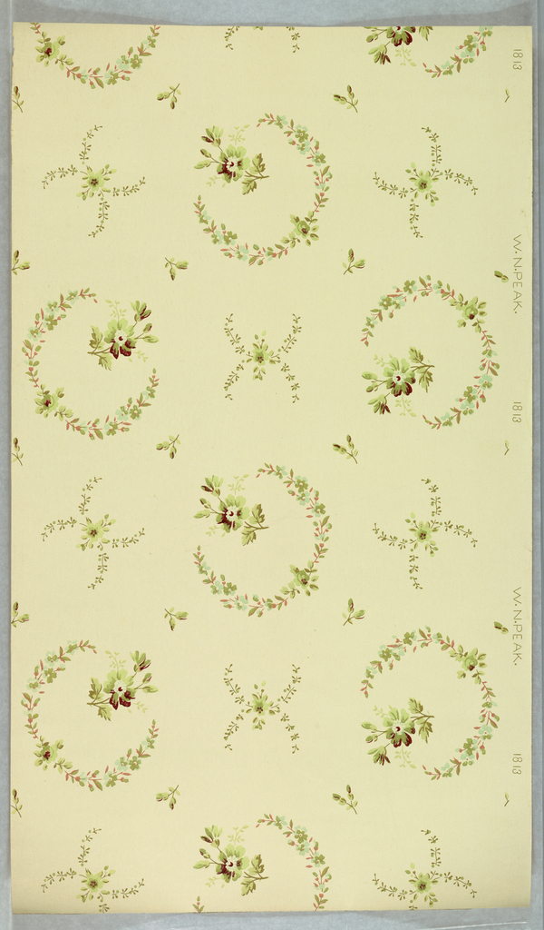 Floral wreaths with floral sprig at top center, alternates with arched floral sprigs with floral motif at join. Printed on light yellow ground.