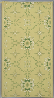 Alternating large and small acanthus medallions, enframed and/or separated by acanthus scrolls. Printed in green and white mica on light green ground.
