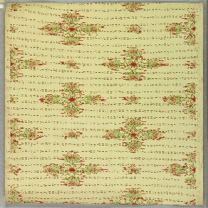 Art Nouveau / Mission Style. Quatrefoil formed with stylized floral motifs. This alternates with a single floral motif. Printed in pinks, greens, brown, and yellow on a black dotted background. Light green ground.