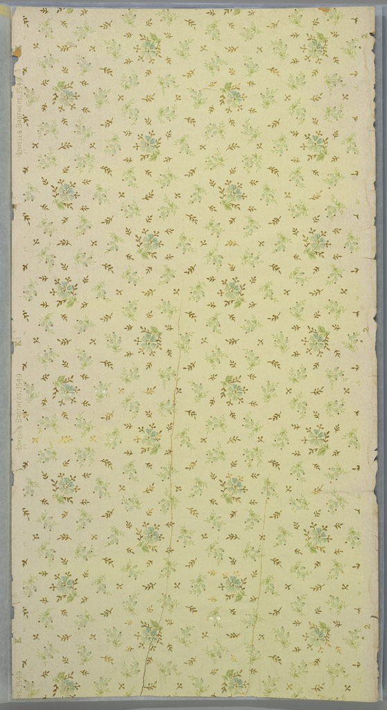 Small floral springs printed in columns or diagonal rows. The fill in between contins very petite floral sprigs and foilate sprigs. Printed in green, blue, and metallic gold on light green ground.