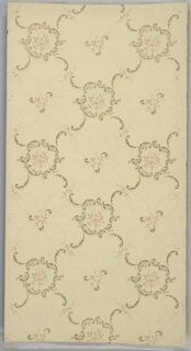 "Alternating scroll medallions with three pink flowers and foliate vining medallions with two pink flowers; connected by flowers and foliate scrolls. Cream ground. Printed in piniks, green, white mica and gold mica. Printed in selvedge: ""Philadelphia"" ""New York"" ""Kayser & Allman"" ""Chicago"" ""Minneapolis"" Pattern number ""1130"""