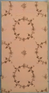 Floral wreaths (with berries?) and small bouquets. Ground is pink. Printed in brown mica. Reattached corner.
