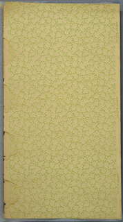 Non-directional design of foliate sprigs and petite stylized floral motifs. Printed in shades of green and mica on off-white ground.