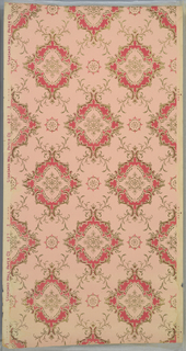 Large foliate medallions with fleuron insets, floiate swags, and scrolls, connected by vining scrolls. Printed in pinks, red, gold mica. 