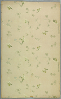 Seemingly random placement of floral sprigs interspersed with foliate sprigs which appear like Japanese maple leaves. Non-directional design. Printed in green, brown, and white mica on off-white ground.