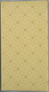 "All-over lattice pattern of stylized floral motif and foliate scrolls. Small four petal flower in center of square spaces. Background of metallic white oval dots. Beige ground. Printed in tan, dark beige, beige-green, white and white liquid mica. Printed in selvedge: "" Carey Bros. W. P. Mfg Co."" Pattern number ""217"""