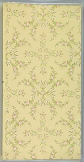 Alternating floral medallions and floral vining with bows connected by rose vining. Light yellow ground. Printed in greens, pinks, white and gold mica. Taped tear across center.
